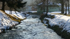 Suburban Area With Creek Passing Through  Stock Footage
