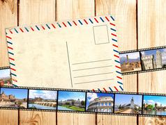 Old filmstrips and postcard - stock photo