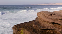 Waves crashing on rocks and beach in San Diego - stock footage