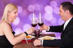 Portrait Of Happy Couple In Restaurant Stock Photos