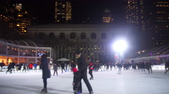 People Ice Skating in Bryant Park Stock Footage