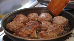 Fried Pork Meatballs or Cutlets in Frying Pan Stock Footage