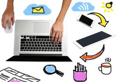 Laptop with work equipments around - stock photo