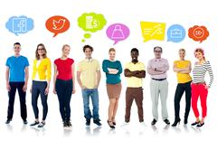 Diversified people with graphic modern icons - stock photo