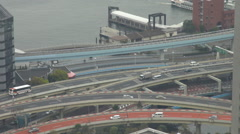 Aerial view Tokyo freeway traffic car port district interchange elevated street  Stock Footage