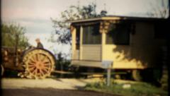 196 - farm tractor pulling motor home to new location - vintage film home movie Stock Footage