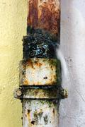 Pipe broken with water leak Stock Photos