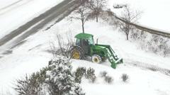 4K overhead shot of John Deere tractor plowing snow Stock Footage