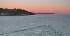 4K Tracking Shot of Boat on Purple Horizon after Sunset Stock Footage