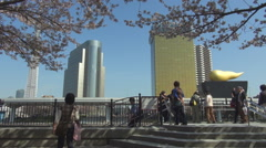 Asahi Breweries Headquarters Skytree tower Tokyo landmark cherry tree flower day Stock Footage