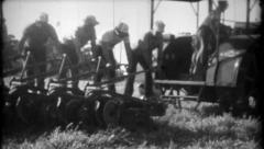 303 - men stand on plow pulled by farm tractor - vintage film home movie Stock Footage