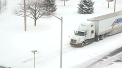 4K big semi truck on snow covered road intersection Stock Footage