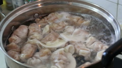 cooking Chinese Jiaozi - stock footage