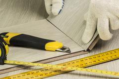 Laying laminate flooring - stock photo