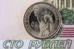 One dollar and one hundred rubles Stock Photos