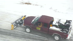 Stock Video Footage of 4K tight overhead shot of pick up truck plowing snow