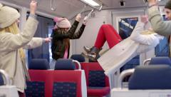 Teens Swing From Hand Holds On A Train, During A Stop, They Play A Game Stock Footage
