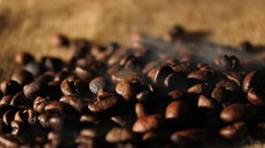 Selected aromatic coffee beans on sackcloth with smoke - stock footage