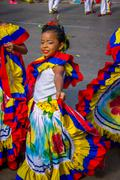 Performers with colorful and elaborate costumes participate in Colombia's most - stock photo