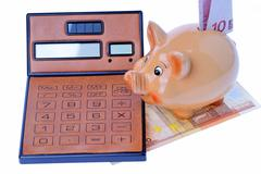 Piggy bank, calculator and euro currency Stock Photos