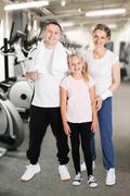 Portrait Of Happy Family At Fitness Gym - stock photo