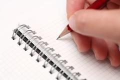 Writing on notepad - stock photo