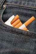 Pack of cigarettes in pocket of jeans - stock photo