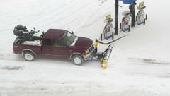 4K full size pickup plowing snow at gas station Stock Footage