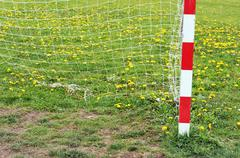 Football goal post and net in spring Kuvituskuvat