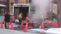 Broken water main flooding steam sinkhole in severe cold weather in Toronto 2015 Stock Footage