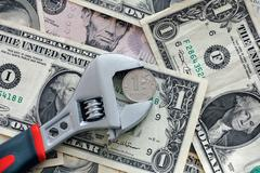 One ruble coin grip in a adjustable wrench Stock Photos