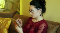 Young Woman Using Tablet Computer In The Living Room Stock Footage