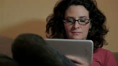Dark Haired Woman With Tablet Computer In The Living Room Stock Footage