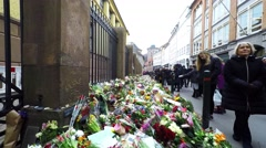 People gather to pay respect for the victims of a terror attack Stock Footage