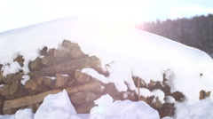 Snow covered firewood stack Stock Footage