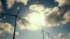 Wind mill turbines blades rotating generating power Stock Footage