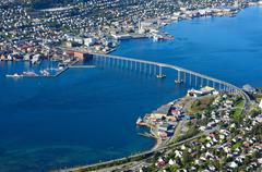 tromsoe city island bridge and blue fjord - stock photo