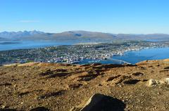 tromsoe city island on summer day with blue fjord - stock photo