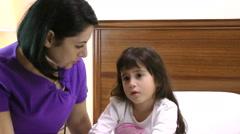 Woman checks child's temperature Stock Footage