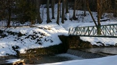 Creek With The Bridge Above At Winter Stock Footage
