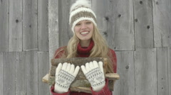 Young woman carrying firewood Stock Footage