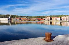 Erandio houses with Nervion river,  bollard and cranes Stock Photos