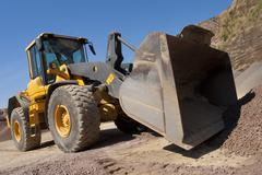 Bulldozer in action in the quarry Stock Photos
