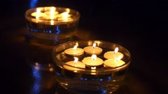 Lighting Candles in Water with Blue Lights in Darkness Stock Footage