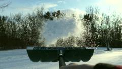 Slow motion snow shoveling with camera attached to shovel - stock footage