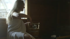 Young woman in sauna - stock footage
