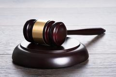 Gavel on the table in legal and justice concept Stock Photos
