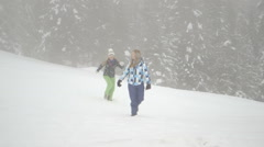 Two young women playing with snow Stock Footage