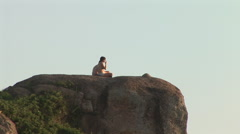 Rio de Janeiro: Couple Seating on a Large Rock Stock Footage