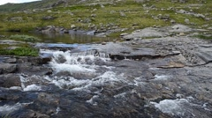Mountain lake river stream with waterfall downstream in summer Stock Footage
